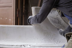 Man working with foam and glue Royalty Free Stock Images