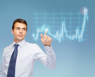 Man working with forex chart on virtual screen Stock Images