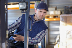 Man working with forklift in warehouse Stock Image