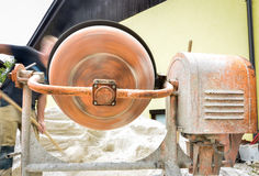 Man working with front of concrete cement mixer at construction Stock Photos
