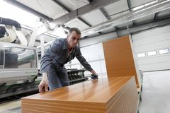 Man working in furniture factory Royalty Free Stock Image