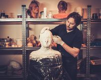 Man working in a fx workshop. Men during lifecasting process in a prosthetic special fx workshop Stock Photo