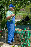 A man working in the garden Stock Photo