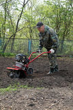 Man working in the garden preparing ground cultivator Royalty Free Stock Images