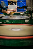 Man Working a Glass Blown Vase on Silica Sanding Disk Stock Photos