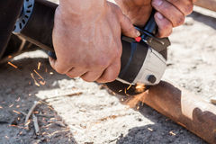 Man working with grinder Stock Photography