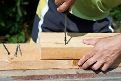 Man working with a hammer Stock Images