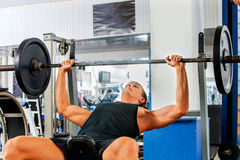Man working his arms and chest at gym Royalty Free Stock Images