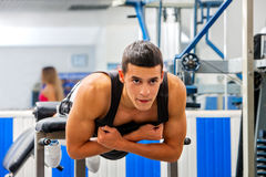 Man working his  back on hyperextension bench Stock Photos