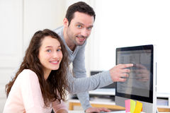 Man working with his co-worker on computer Royalty Free Stock Photography