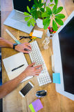Man working at his desk and typing on keyboard Royalty Free Stock Photography