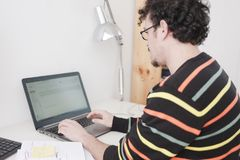 Man working on a home studio stock photography