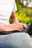 Man working on his laptop Stock Image