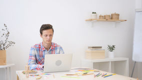 Man working on his laptop in creative office, Busy on New Project stock photos