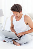 Man working on his laptop at home Royalty Free Stock Image