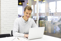 Man working at his laptop on the office in start-up Royalty Free Stock Images