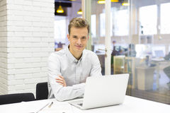 Man working at his laptop on the office in start-up Stock Image