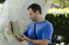 Working outside on a laptop alone. royalty free stock photo