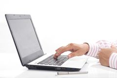 Man working on his laptop Stock Photos