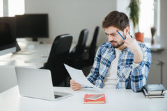 Man working at his office with papers Stock Images