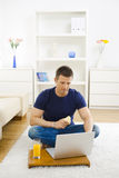Man working at home Stock Images