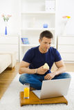 Man working at home Stock Image