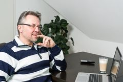 Man working from home on laptop computer Stock Photo