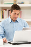 Man Working From Home Using Laptop Royalty Free Stock Photography