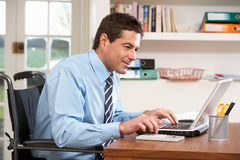 Man Working From Home Using Laptop Royalty Free Stock Photo