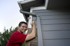 Man Working on House - Horizontal Stock Image