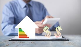 Free Man Working In Office. House And Dollar Symbols. Energy Efficiency Stock Images - 194331974