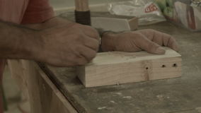 Man working indoors in hobby shed or workshop with carpentry power tools stock video footage