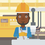 Man working on industrial drilling machine. Royalty Free Stock Photography