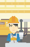 Man working on industrial drilling machine. Stock Photo