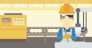 Man working on industrial drilling machine. Royalty Free Stock Images