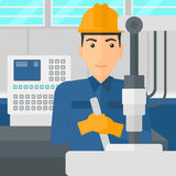 Man working with industrial equipment. Royalty Free Stock Images