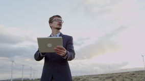 A man working with ipad in the countryside stock video