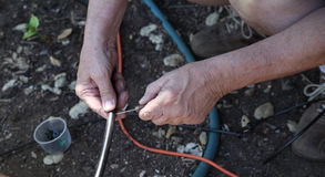 Man working on irrigation emitters Royalty Free Stock Images