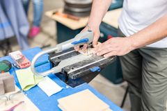 Man working with jig saw. Fretsaw tool stationary fixed on table. Person making wooden figures with electric saw tool.  Stock Photos