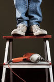 Man working on ladder Royalty Free Stock Photo