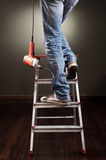 Man working on ladder. With drill royalty free stock images