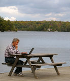 Man working at a lake Royalty Free Stock Photography