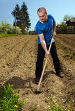 Man working the land Stock Photography