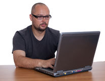 Man working on laptop Stock Image