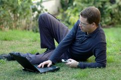Man Working on Laptop. Out side in the park Royalty Free Stock Photo