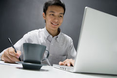 Man working on laptop Stock Photos