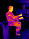 Man working on laptop. Thermographic image of man working on laptop computer Royalty Free Stock Images