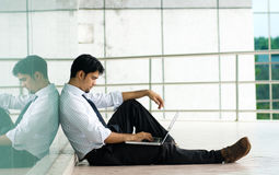 Man working on laptop. Corporate male working on laptop at office corridor Stock Images
