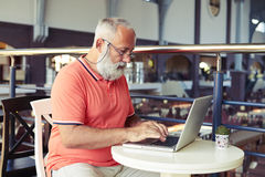 Man working with laptop in cafe Royalty Free Stock Photo