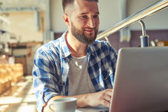 Man working with laptop in cafe Royalty Free Stock Photography